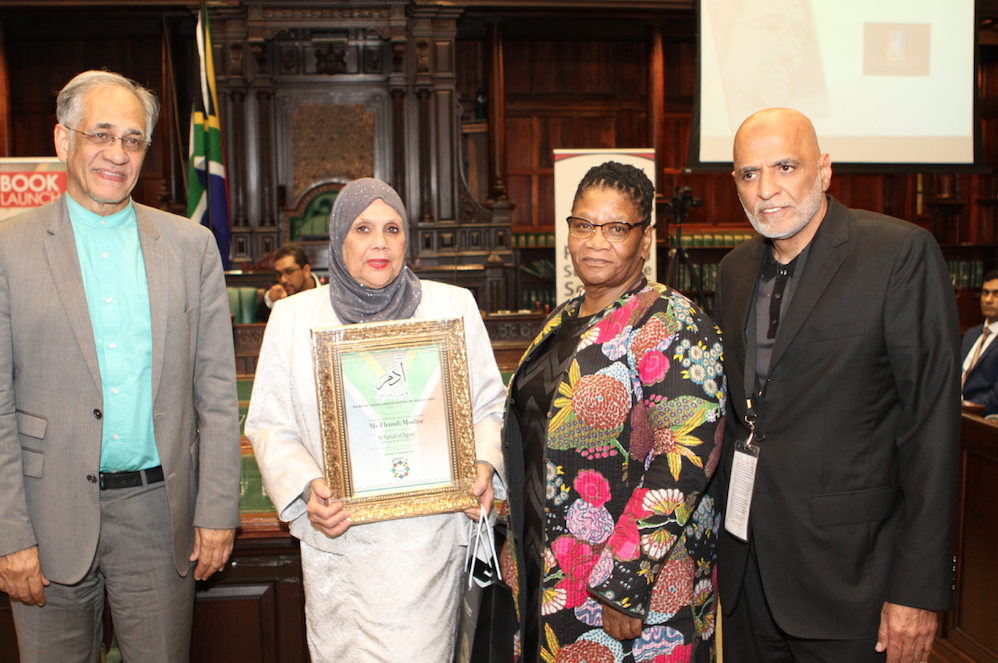 CAPTION: L-R. The author Enver Surty, Nadia Collier (Awqaf SA), Thandi Modise, Speaker of Parliament and Haroon Kalla (Awqaf SA).